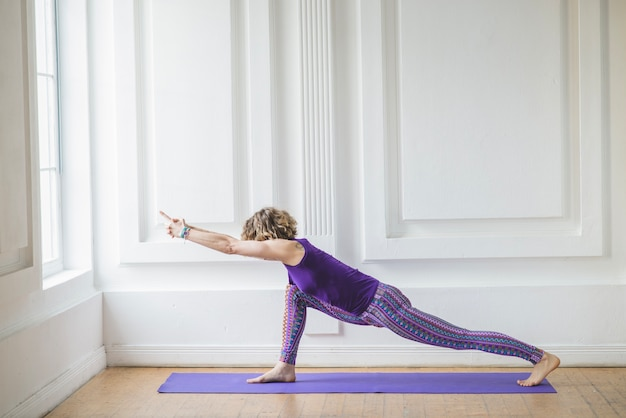 Woman meditating and stretching
