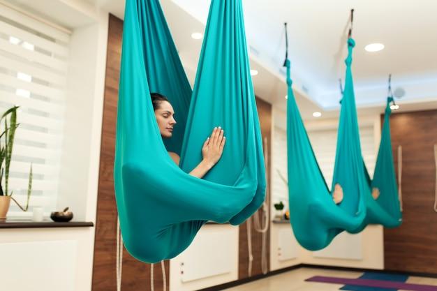 Woman meditation in hammock.