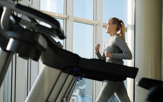 Woman of middle age working out in gym