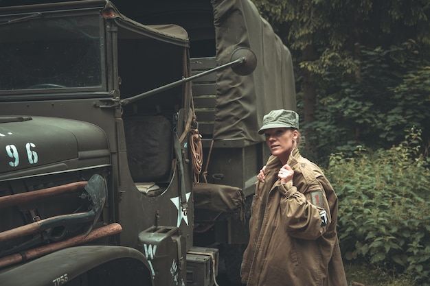 Woman in a military uniform in an army car