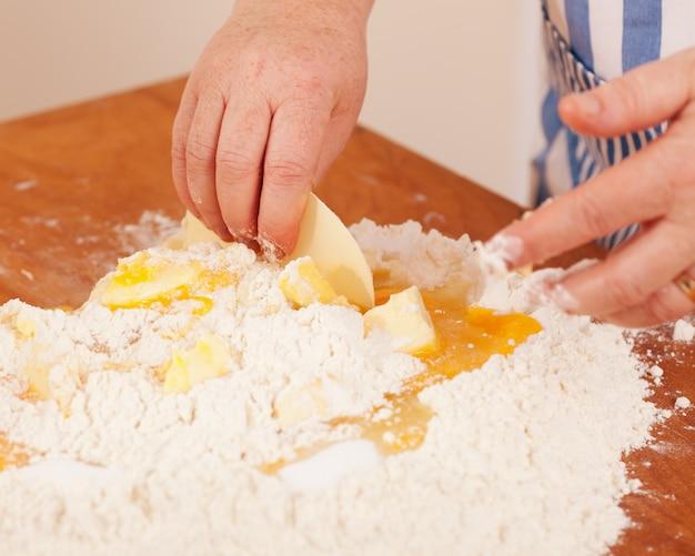 Woman mixing dough