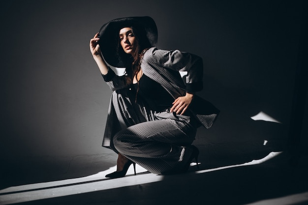 Woman model in a business suit wearing a hat