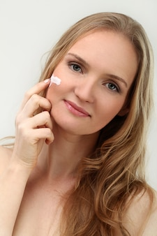 Woman model possing with face cream