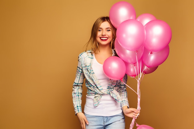 Woman model with pink air balloons