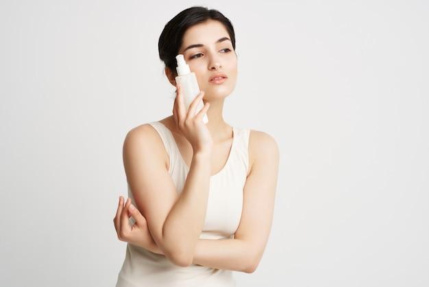 Woman moisturizing cream clean skin cosmetology closeup