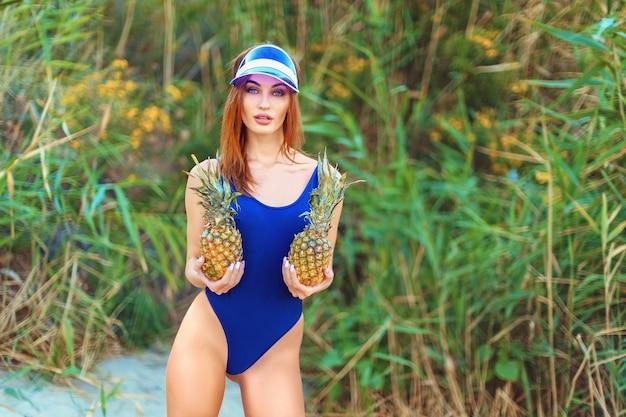 Woman in a monokini on the sea shore of a tropical island