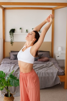 Woman in the morning does exercises at home. yoga and meditation at home. international yoga day