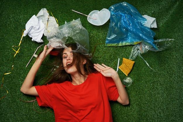 Woman mountain of garbage, sorting garbage, garbage emissions into nature