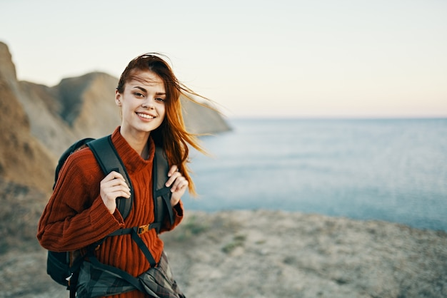 Woman in the mountains active vacation travel sea rocks landscape model. high quality photo