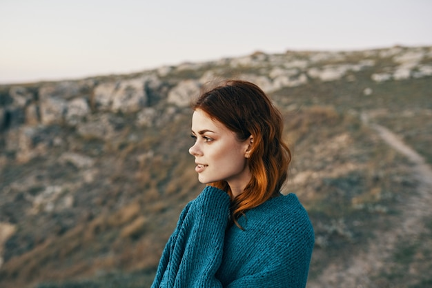 Woman in the mountains nature travel plaid cool. high quality photo