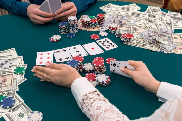 Woman moving all her chips for a bet