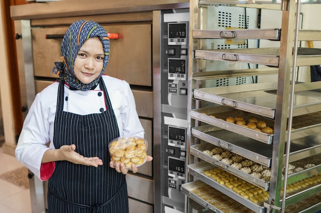 Woman muslim food entrepreneur with her product