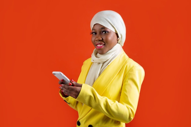 Woman in muslim headscarf with mobile phone