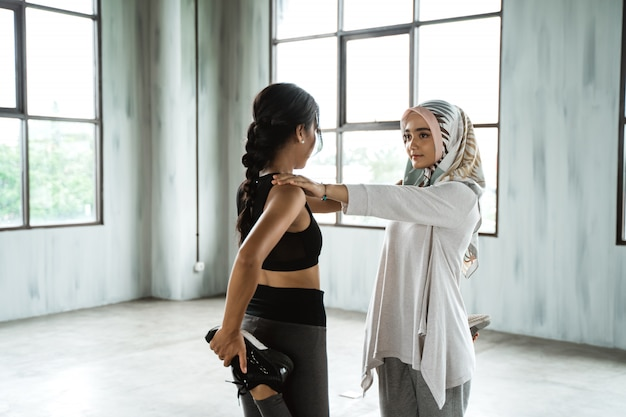 Woman muslim warming up before workout