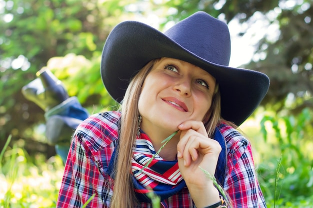 Woman in nature dressed in western style
