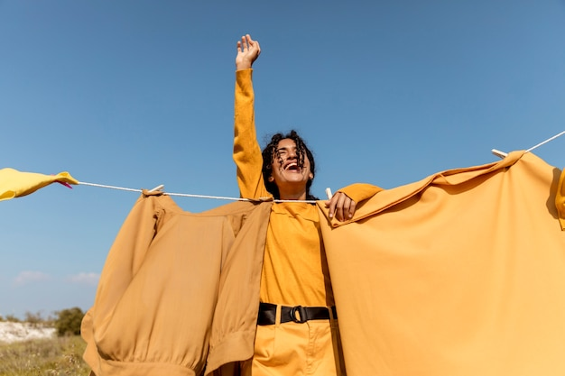 Woman in nature with clothesline