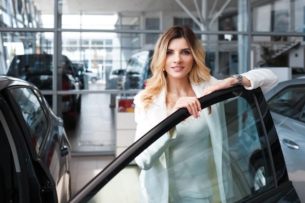 Woman near new car