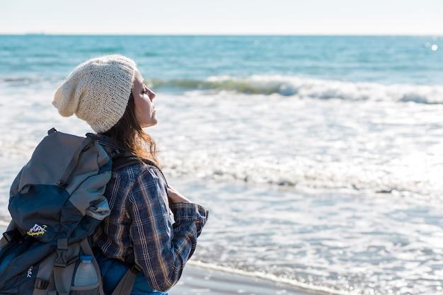 Woman near ocean enjoying breeze