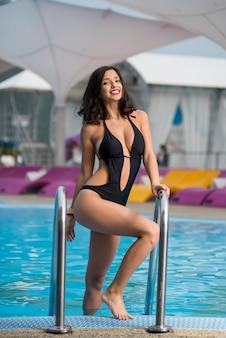 Woman near swimming pool on resort