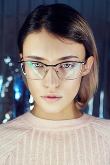 Woman in neon colored reflection glasses, makeup