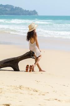 Woman nude in a nude beach