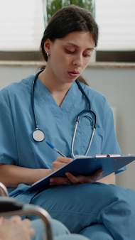 Woman nurse examining healthcare of retired patient