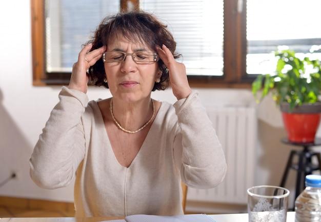 Woman in the office has a headache