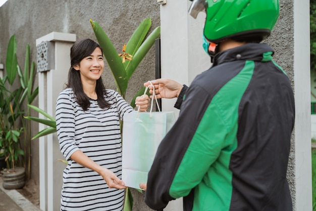 Woman online shopping get her package