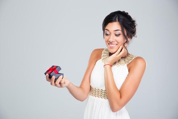 Woman opening jewelry gift box