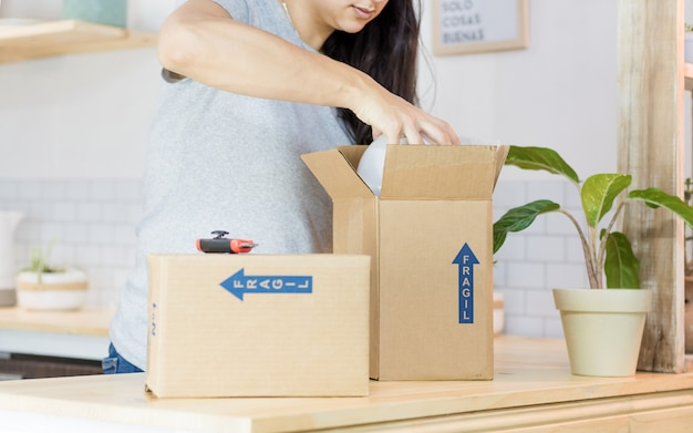 Woman opening a package with cutter