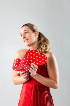 Woman opening present for valentines day