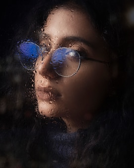 Woman in optique glasses with blue shadow