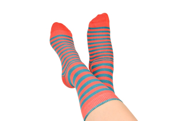 Woman in orange socks isolated on white background. top view.