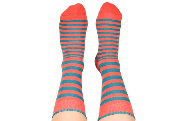 Woman in orange socks isolated on white