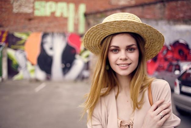 Woman outdoors in city walk travel graffiti lifestyle.
