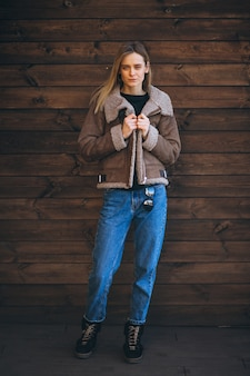 Woman outside on the wooden background
