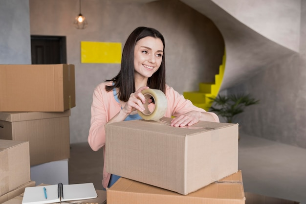 Woman packing boxes to deliver