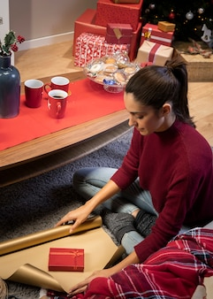 Woman packing gift for holiday