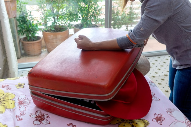 Woman packing a luggage