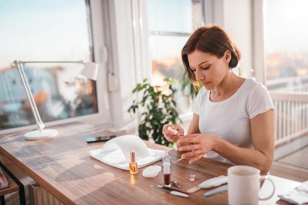 Woman paining nails