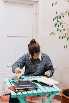 Woman painting at table