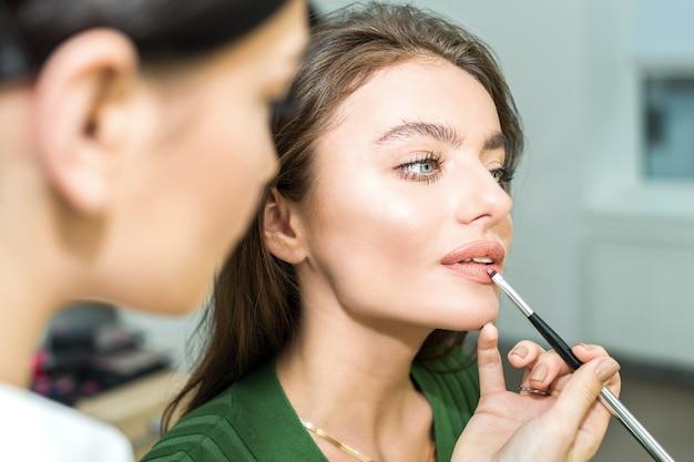 Woman paints the lips