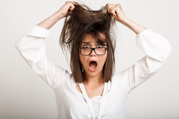 Woman in panic tousle hair
