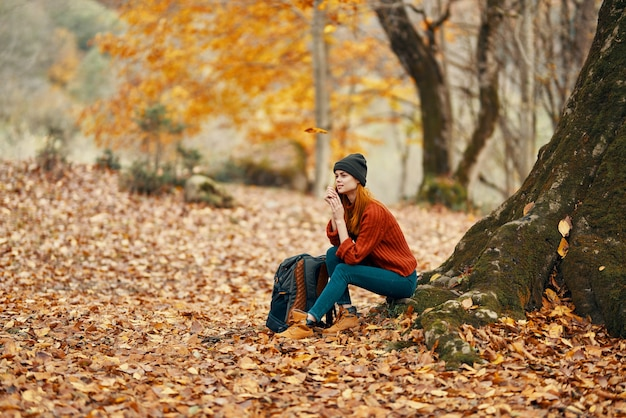 Woman in the park landscape falling leaves travel nature