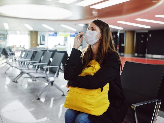 Woman passenger at the airport medical mask waiting