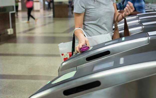 Woman passing automatic door at subway station