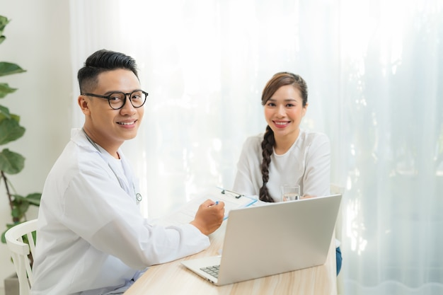 Woman patient consulting with doctor or psychiatrist on obstetric