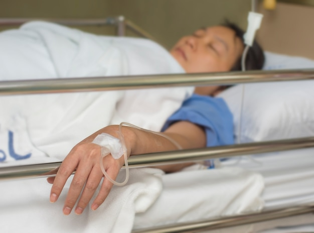 Woman patient in the hospital with saline intravenous
