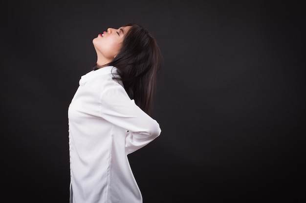 Woman patient suffering from back pain, backbone disc or spinal muscle injury