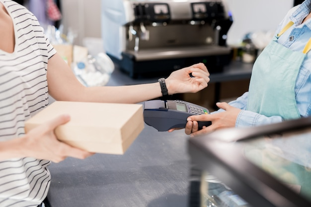 Woman paying by nfc in shop
